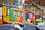 Many Chinese street signs are displayed along downtown Chinatown in Toronto