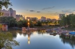 Photo of The Forks along the Assiniboine River in Winnipeg City at sunset, Manitoba.