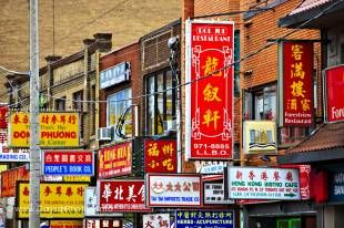 Street signs along the ethnic enclave in downtown Toronto, which is known as Chinatown and is one of the largest in North America.