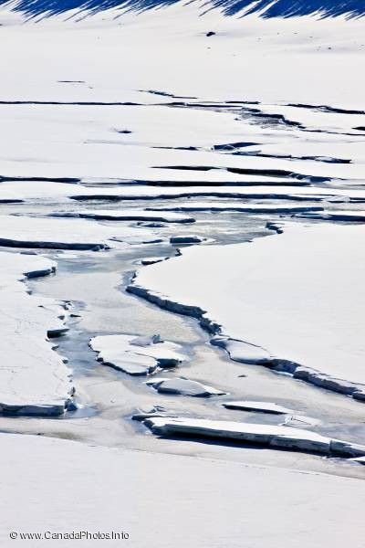 photo of Abstract Winter Ice Channels On Lake