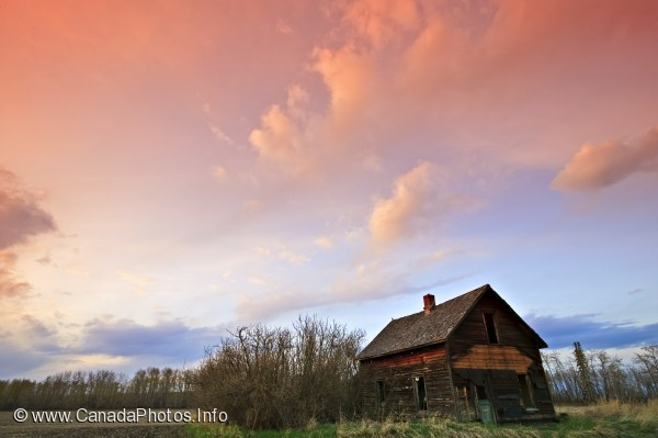 photo of Old shed sunset dramatic clouds Alberta