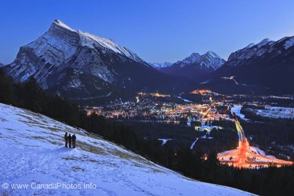 photo of People Overlooking Banff Town Dusk Winter