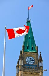 Picture of the Canadian Flag in front of the Parliament Building